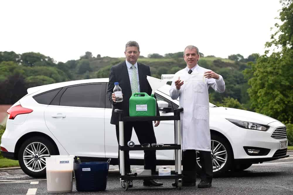 FREE FIRST USEMark Simmers from Celtic Renewables(L) and Professor Martin Tangney with the world's first car to be fuelled by whisky residue biofuel takes it's inaugural journey. See Centre Press story CPFUEL; The world's first car running on a biofuel made from WHISKY residue has had its first successful test drive. The fuel - biobutanol - is a brand new type of sustainable fuel and is designed to be a direct replacement for petrol and diesel. It is produced from draff - the sugar-rich kernels of barley which are soaked in water to facilitate the fermentation process necessary for whisky production. The other main ingredient is pot ale, the copper-containing yeasty liquid that is left over following distillation. Unlike other biofuels, biobutanol can be used as a direct replacement for road fuels like petrol or diesel.Lesley Martin 07836745264 lesley@lesleymartin.co.uk www.lesleymartin.co.ukAll images © Lesley Martin 2017. Free first use only for editorial in connection with the commissioning client's press-released story. All other rights are reserved. Use in any other context is expressly prohibited without prior permission.