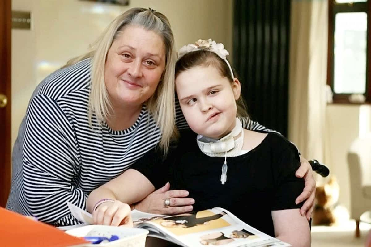 "Emma Garbutt and her daughter Millie.  A young girl who lost her voice after brain tumour surgery can now only communicate using her iPad - and SIRI. See NATIONAL story NNIPAD.  Millie Garbutt was left unable to speak after having a life-saving tracheotomy after doctors operated on a brain tumour.  Now the 12-year-old has to communicate using the text-to-speech function on her tablet computer - that uses the same voice as Apple's 'virtual assistant' Siri.  Mum Emma Garbutt said: ""She has an iPad and another electronic device which attaches to her wheelchair and helps her communicate with everyone."