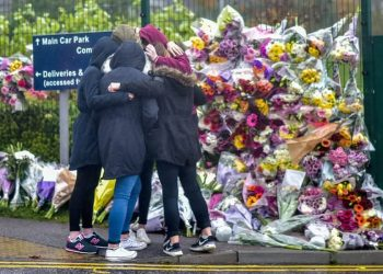 FILE PICTURE - A group of girls console each other in front of a floral tribute in memory of Bailey Gwynne is seen outside the gates to Cults Academy near Aberdeen, Scotland on October 29 2015.See Centre Press story CPBAILEY; This is the face of the killer who stabbed a fellow school pupil to death and can legally be named for the first time after turning 18-years-old. Daniel Stroud was found guilty of stabbing Bailey Gwynne to death in the corridors of a high-achieving secondary school as an argument took a dark turn for the worse. Stroud regularly brought knives with him to Cults Academy in Aberdeen prior to the incident which cost Bailey his life on October 28 of 2015. The fight was said to have started over a biscuit and escalated when someone called Bailey's mum fat.