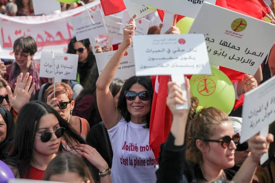 """Women chant slogans while raising placards which read in Arabic """"equality in inheritance is a right not a favor"""", during a march held in Tunis, Tunisia to call for equal inheritance rights and gender equality. Photos © Chedly Ben Ibrahim for Equality Now"""