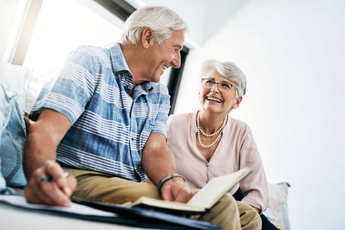 Shot of a senior couple going through their paperwork together at home