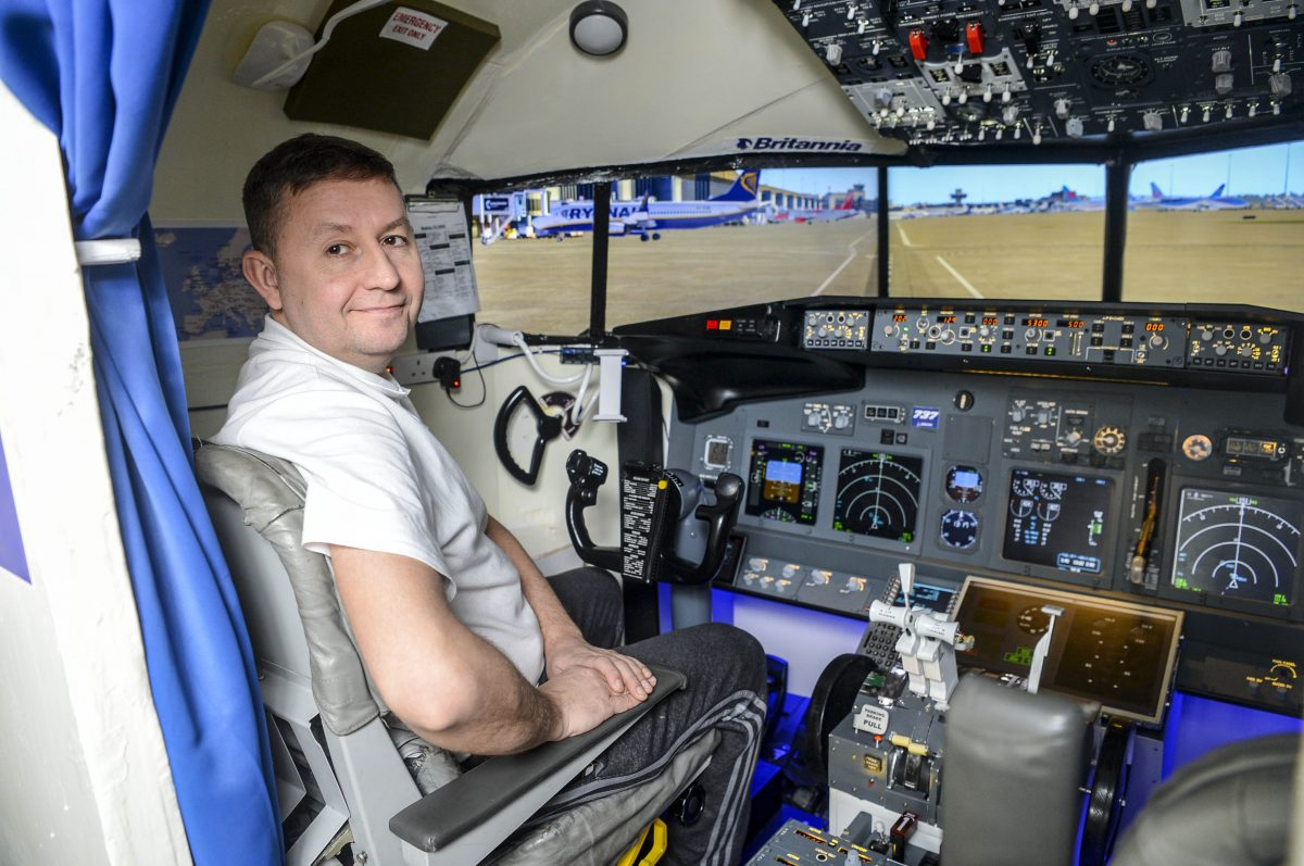 Plane-loving father of two builds flight simulator in dining