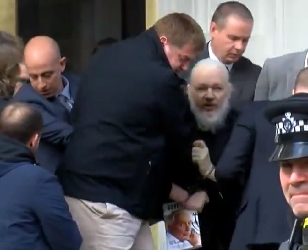 Julian Assange carried out of Ecuadorean Embassy