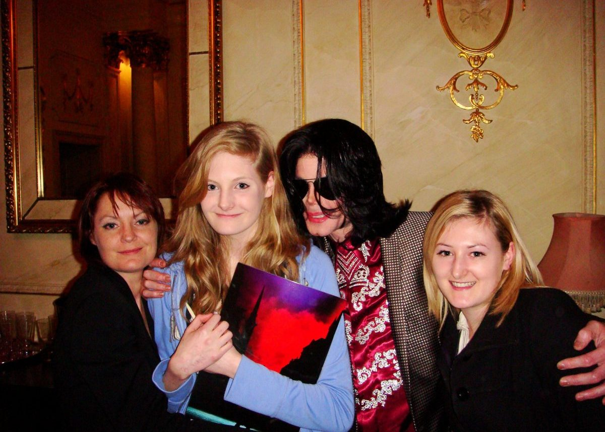Lucy Lester, right, has defended godfather Michael Jackson, second right, against allegations of sex abuse in recent documentary Leaving Neverland. Also pictured are Lucy's mother Lisa, far left, and sister Harriet, second left. They are pictured with the star in London in March 2009 months before his death