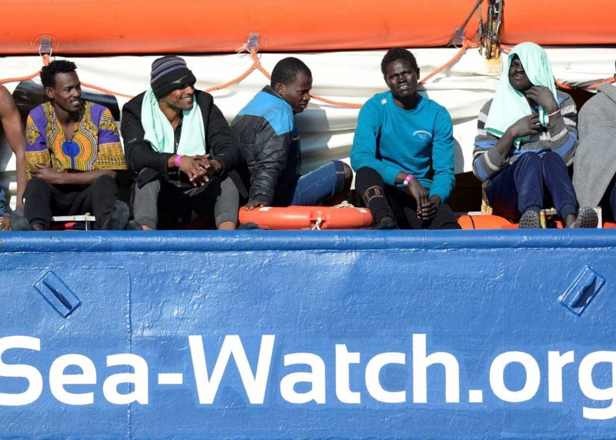 FILE PHOTO: Migrants rest on board the Sea Watch 3 off the coast of Siracusa, Italy, January 27, 2019. REUTERS/Guglielmo Mangiapane/File Photo