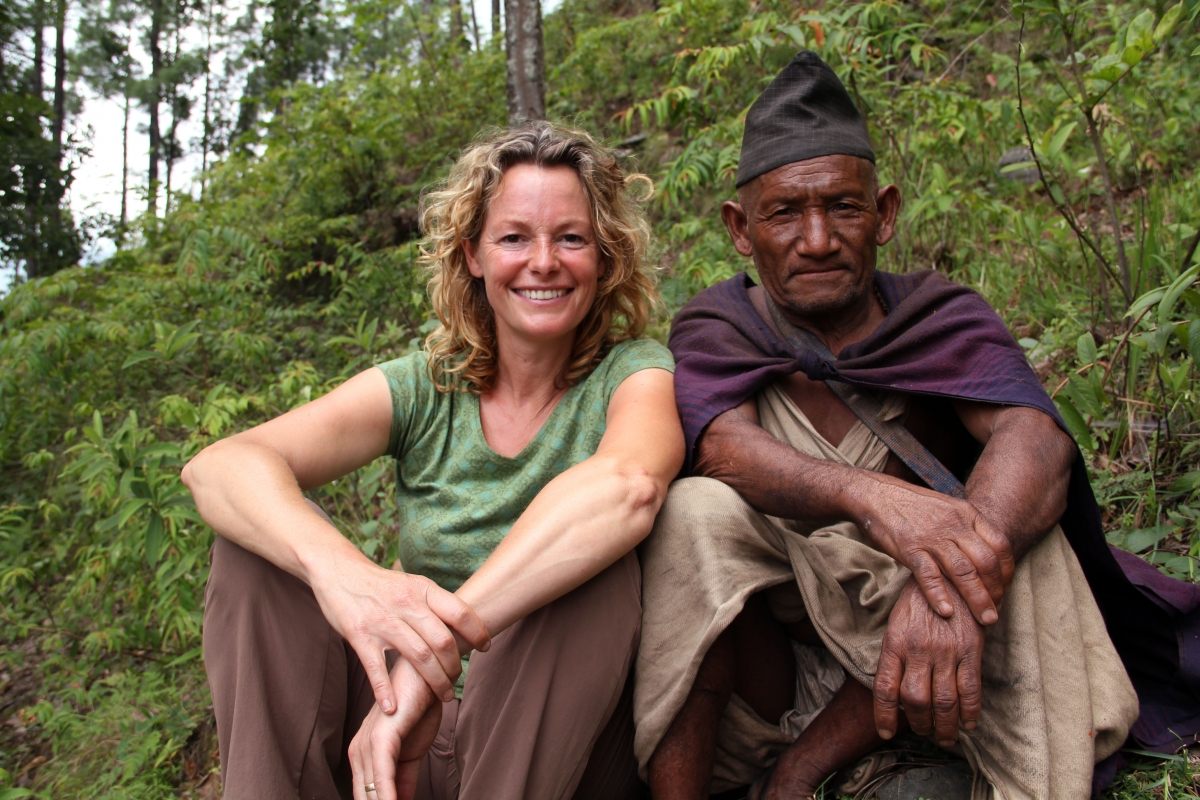 Programme Name: Kate Humble: Living with Nomads - TX: 05/06/2015 - Episode: Kate Humble: Living with Nomads - Nepal (No. 1) - Picture Shows: Presenter Kate Humble sat with Mein Bahadur (Raute elder), Nepal - (C) Indus Films - Photographer: Kate Owen