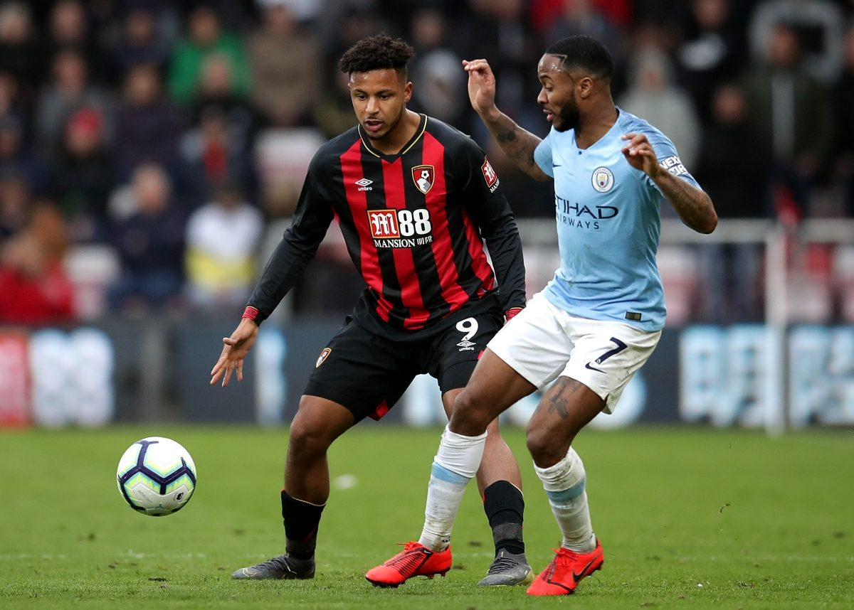 Bournemouth's Lys Mousset (left) and Manchester City's Raheem Sterling battle for the ball during the Premier League match at the Vitality Stadium, Bournemouth.