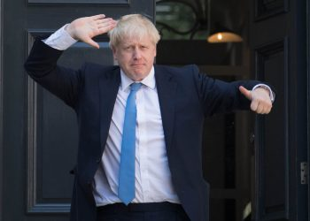 Boris Johnson poses outside Number 10 Downing Street (PA)