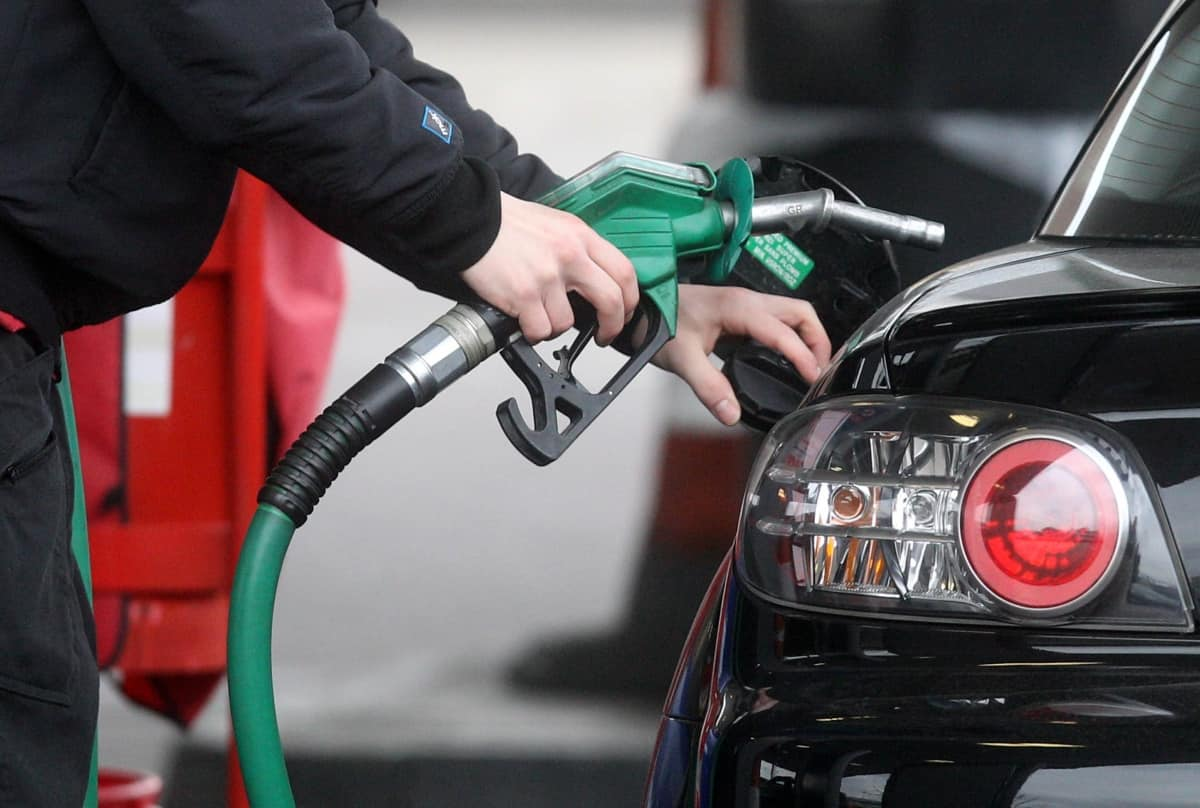 Embargoed to 0001 Wednesday April 03 File photo dated 22/02/13 of a person using a petrol pump. New figures show fuel prices have risen for the second consecutive month.