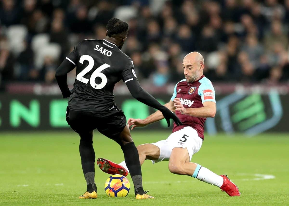 West Ham United's Pablo Zabaleta (right) slides in on Crystal Palace's Bakary Sako (left) during the Premier League match at the London Stadium, London.