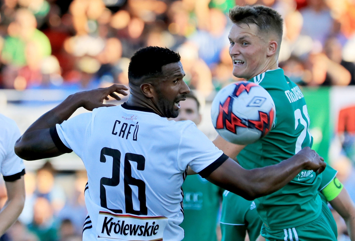 Legia Warszawa's Cafu and Cork's Sean McLoughlin battle for the ball during the UEFA Champions League first qualifying round, first leg match at Turners Cross, Cork.