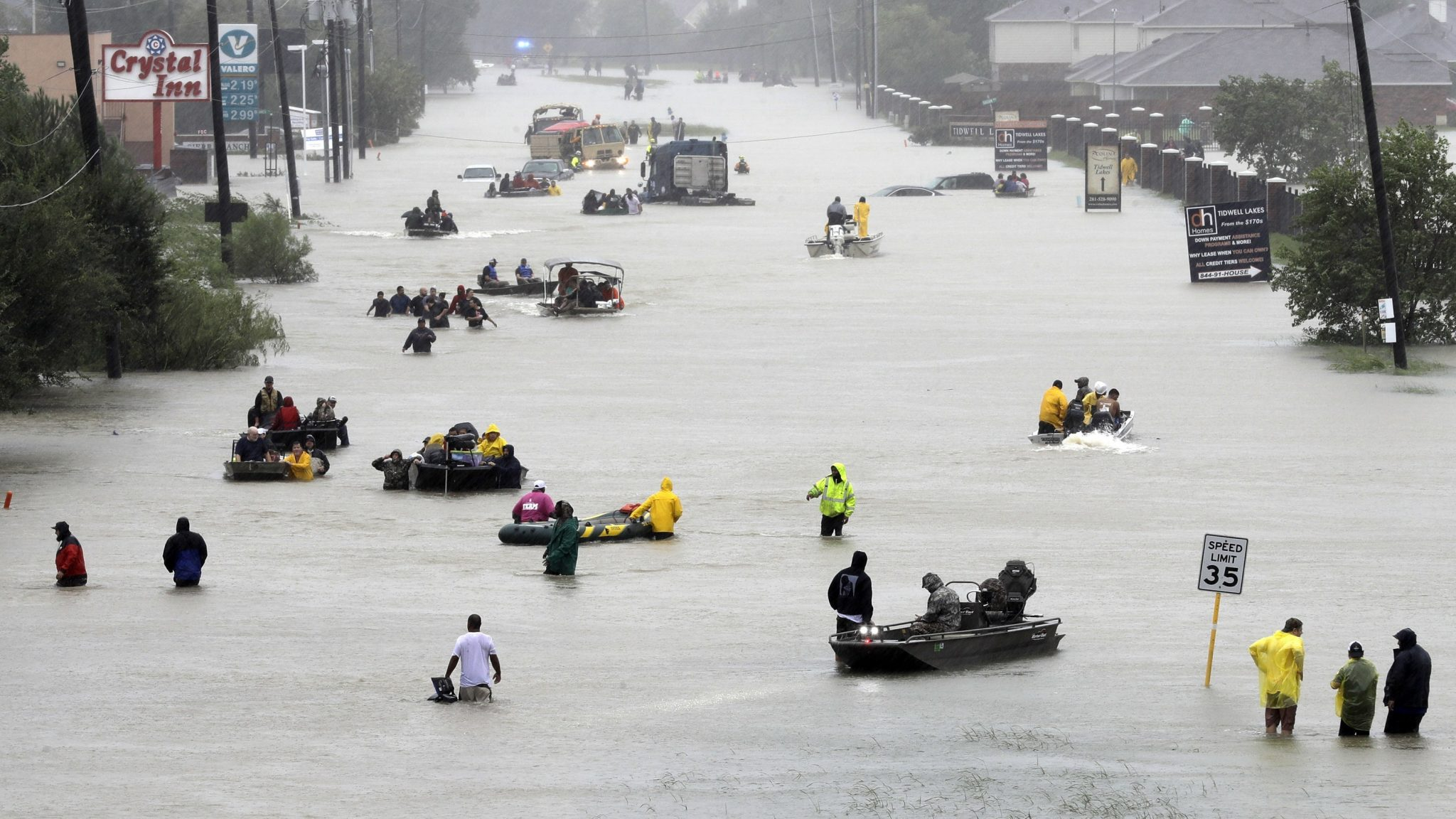 Rescue boats fill a flooded street in Houston after Hurricane Harvey, 2017 (David J Phillip/AP)