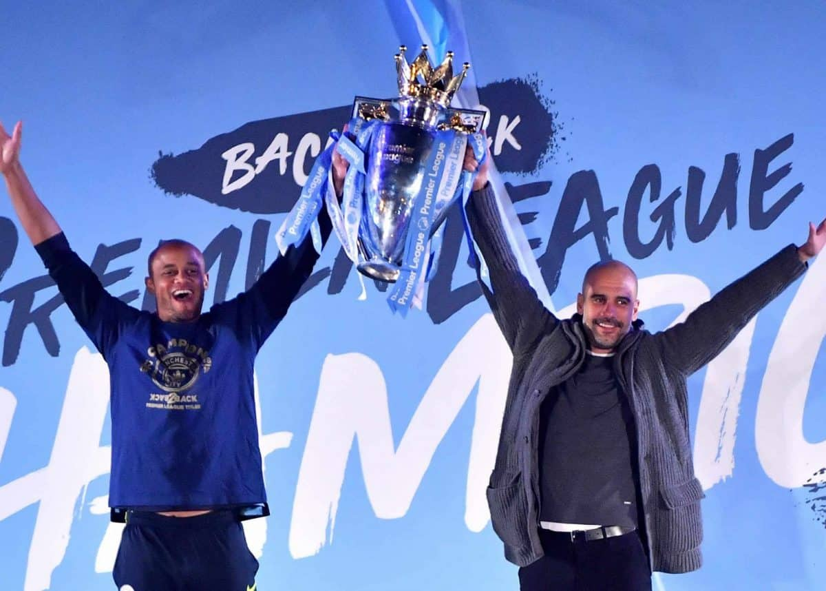 Vincent Company and Pep Guardiola celebrate Manchester City Premiership win