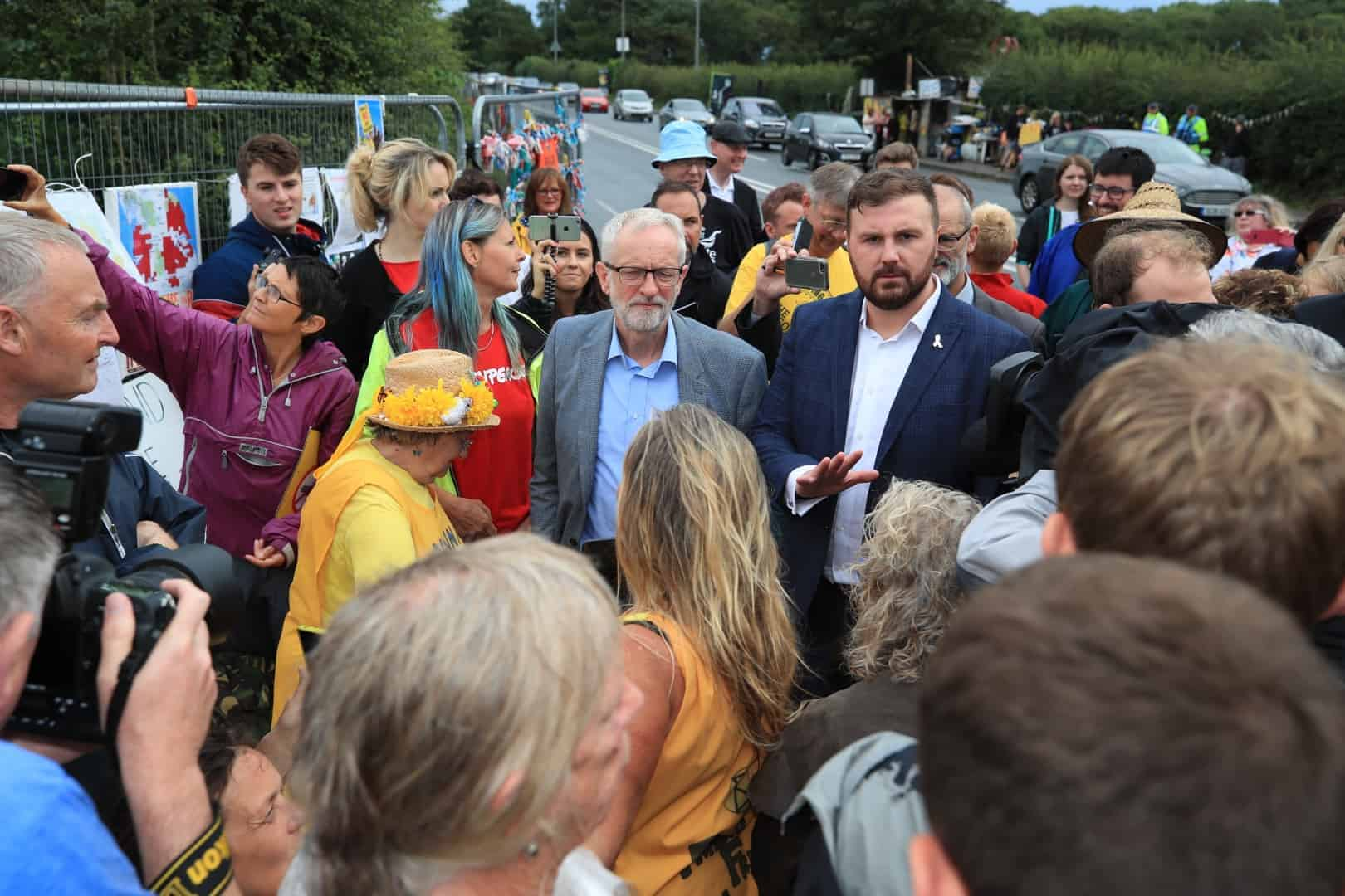 Jeremy Corbyn speaks to anti-fracking protesters outside the gate at the Preston New Road shale gas exploration site in Lancashire (Peter Byrne/PA)