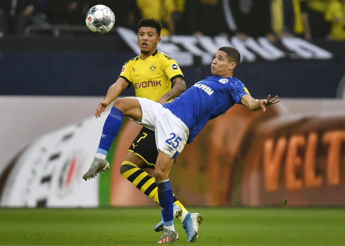 Schalke's Amine Harit, right, and Dortmund's Jadon Sancho challenge for the ball during the German Bundesliga derby soccer match between FC Schalke 04 and Borussia Dortmund in Gelsenkirchen, Germany, Saturday Oct. 26, 2019. (AP Photo/Martin Meissner)