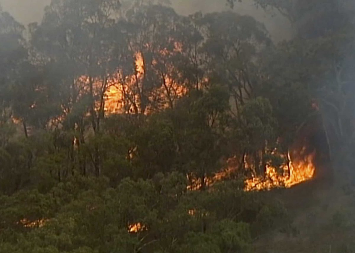 In this image made from video, an aerial scene showsfires burning in Bundoora, Victoria state, Monday, Dec. 30, 2019. New Year's Eve fireworks in Australia's capital and other cities have been canceled as the wildfire danger worsens in oppressive summer heat, and pressure was building for Sydney's iconic celebrations to be similarly scrapped. (Australian Broadcasting Corporation, Channel 7, Channel 9 via AP)