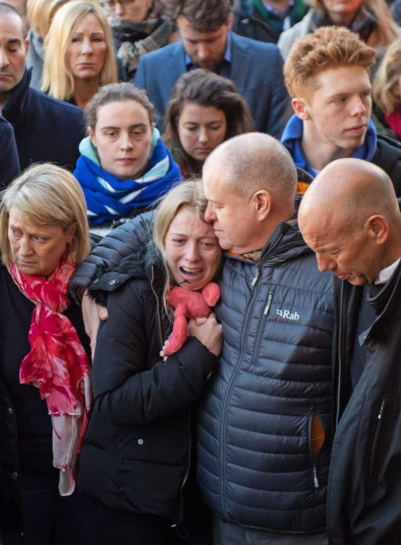 Jack Merritt's girlfriend Leanne O'Brien (centre left) and father David (centre right) during a vigil at the Guildhall in Cambridge to honour both Jack and Saskia Jones after the two of them were killed in Friday's London Bridge terror attack (Joe Giddens/PA)
