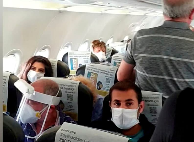 Video grab from a  ''crowded'' repatriation flight from Turkey to the UK on April 28 Credit;SWNS