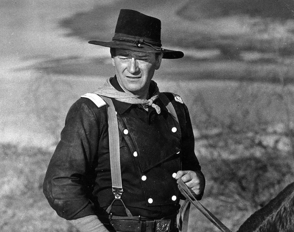 """John Wayne is shown during the filming of """"The Horse Soldiers."""" (AP Photo)"""