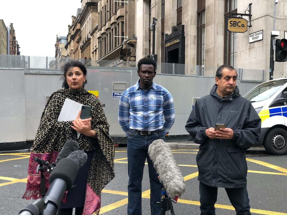 """(left to right) Robina Qureshi from the charity Positive Action In Housing, Andrew (no last name given) an asylum seeker and Mohammad Asif speaking to the media in Glasgow about the asylum seeker """"accommodation crisis"""" in Glasgow after an attack in the city last week.Credit;PA"""