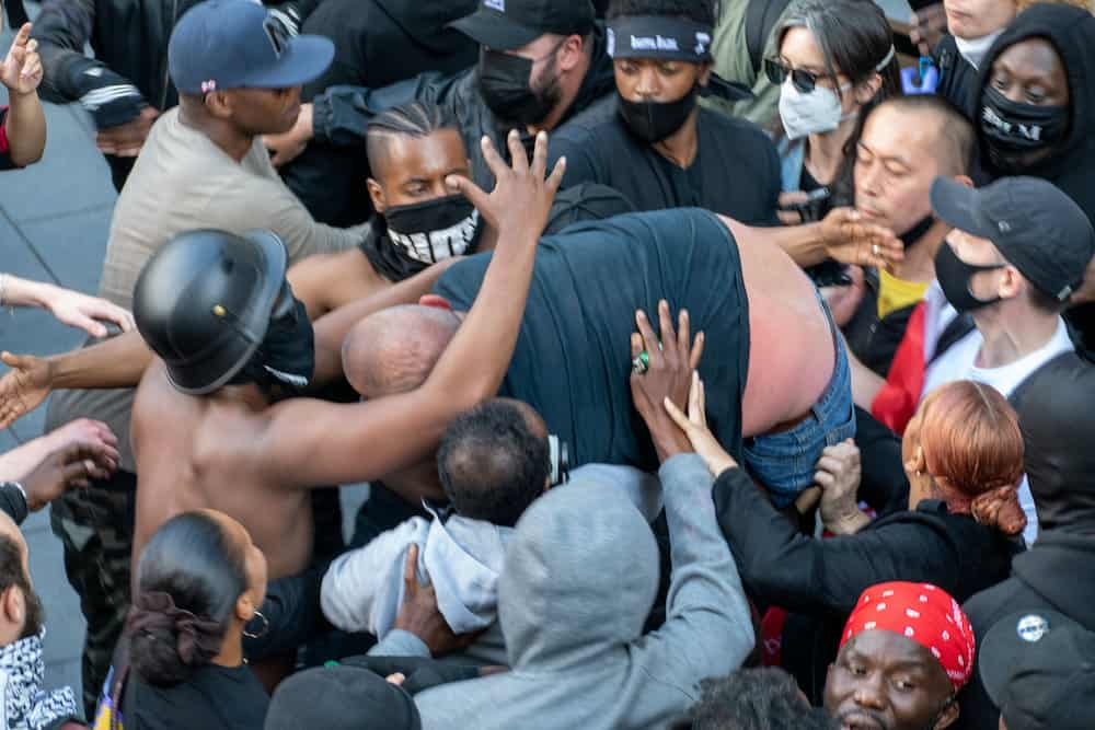 Dramatic photos reveal the melee during the Black Lives Matter protest which led to Patrick Hutchinson and a group of fellow demonstrators saving a white man from the far right racist counter protest after he got into trouble, Waterloo Station, London 13 June 2020. Credit: SWNS