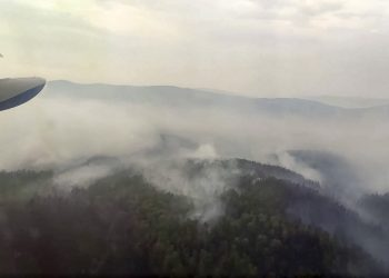 This image taken from video provided by Russian Emergency Ministry, shows a view of a forest fire from a Russian Emergency Ministry multipurpose amphibious aircraft in the Trans-Baikal National Park in Buryatia, southern Siberia, Russia, Thursday, July 9, 2020. About 910 hectares of forest were alight over this area of the Russia's region, according to the ministry of emergency situations. (Russian Emergency Ministry Press Service via AP)