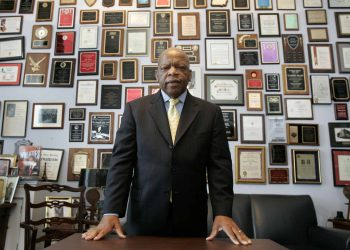 FILE - In this Thursday, May 10, 2007 file photo, U.S. Rep. John Lewis, R-Ga., in his office on Capitol Hill, in Washington. Lewis, who carried the struggle against racial discrimination from Southern battlegrounds of the 1960s to the halls of Congress, died Friday, July 17, 2020. (AP Photo/Susan Walsh, File)