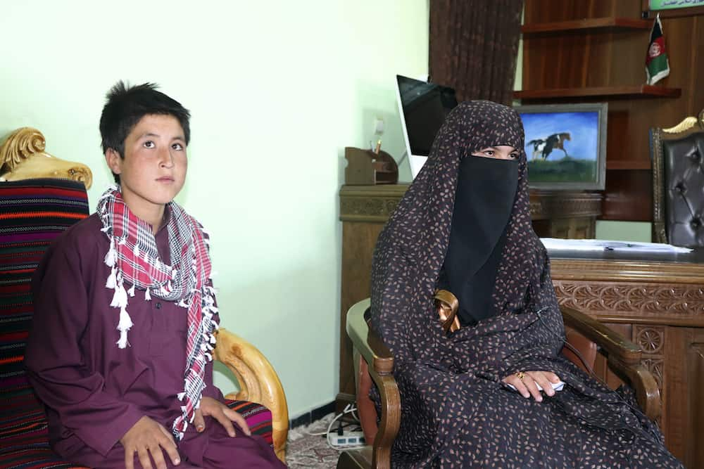 Qamar Gul, 16, right, and her brother Habibullah, 12, left, poses for photograph in the governor house of Ghor province western of Afghanistan, Tuesday, July 21, 2020. A 16-year old Afghan girl who killed Taliban who attacked and killed her parents in western Ghor province has become a local hero. (AP Photo)