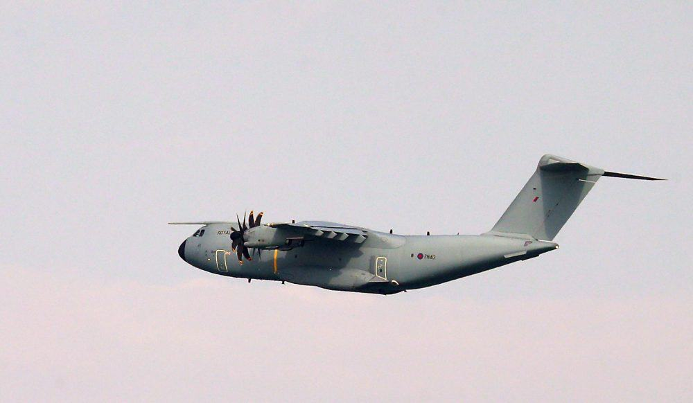 """A view of a Royal Air Force Atlas A400M aeroplane in the skies above Dover in Kent which has provided aerial surveillance as part of an """"initial offer of assistance"""" from the Ministry of Defence to the Home Office in response to the continued migrant crossings.Credit;PA"""