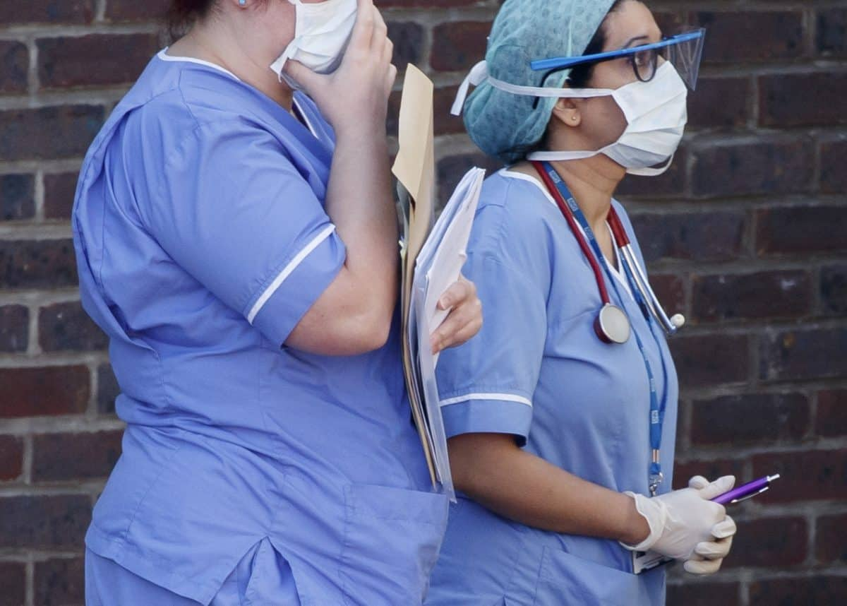 Hospital staff wear face masks outside Doncaster Royal Infirmary, as organisations representing hospital trusts have rounded on the Government over its promise of more personal protective equipment (PPE) to protect workers in the fight against Covid-19.