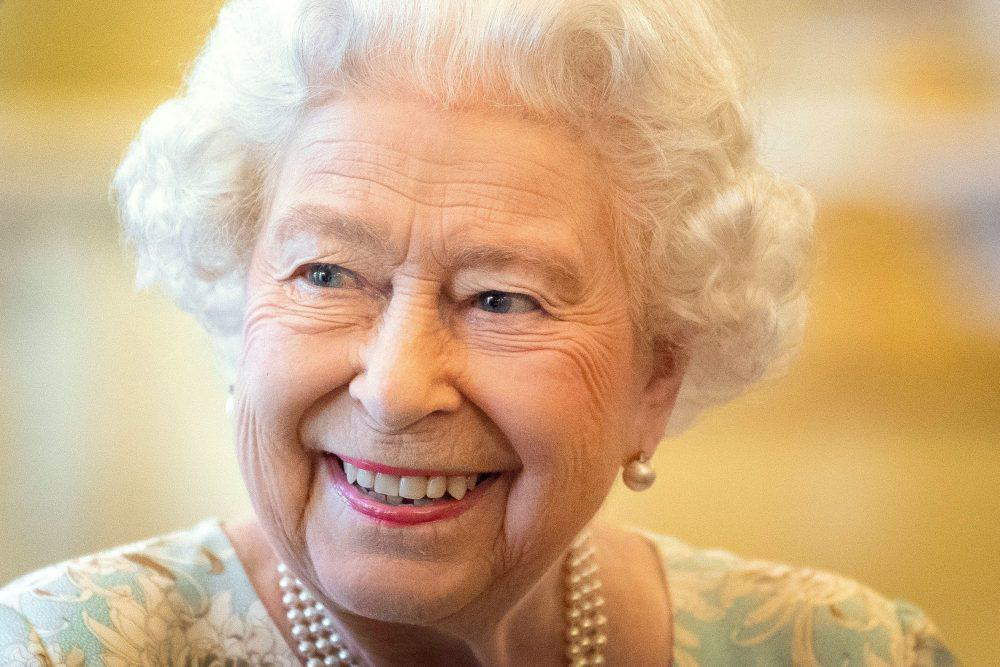 """File photo dated 12/06/14 of Queen Elizabeth II hosting a reception at Buckingham Palace in London, to mark the work of The Queen's Trust. The Queen has led the royal family in paying tribute to the British Red Cross on the eve of its 150th anniversary, describing the charity's work as """"valued and greatly appreciated""""."""