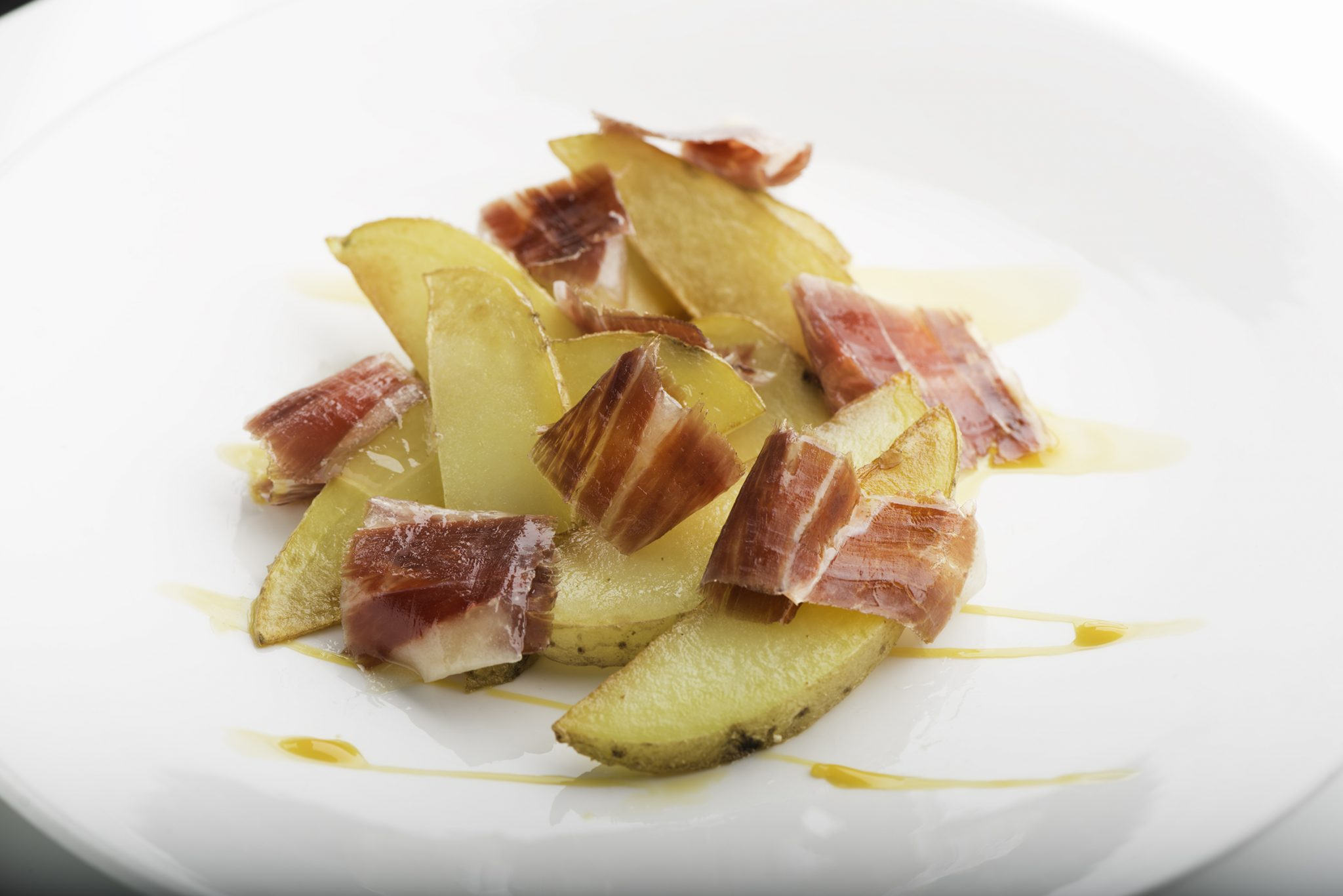 Potato wedges with egg yolks and ham