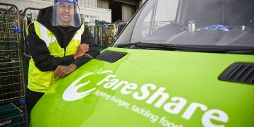EMBARGOED TO 0001 FRIDAY OCTOBER 23 Handout photo issued by Fareshare/Mark Waugh of England football star Marcus Rashford visiting FareShare Greater Manchester at New Smithfield Market, which is naming a new warehouse in his Mother's honour.