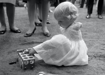 Phillipa Bradbourne, a baby born without arms as a result of Thalidomide, at a party in the 1960s (PA)