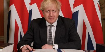 Prime Minister Boris Johnson signs the EU-UK Trade and Cooperation Agreement at 10 Downing Street, Westminster.