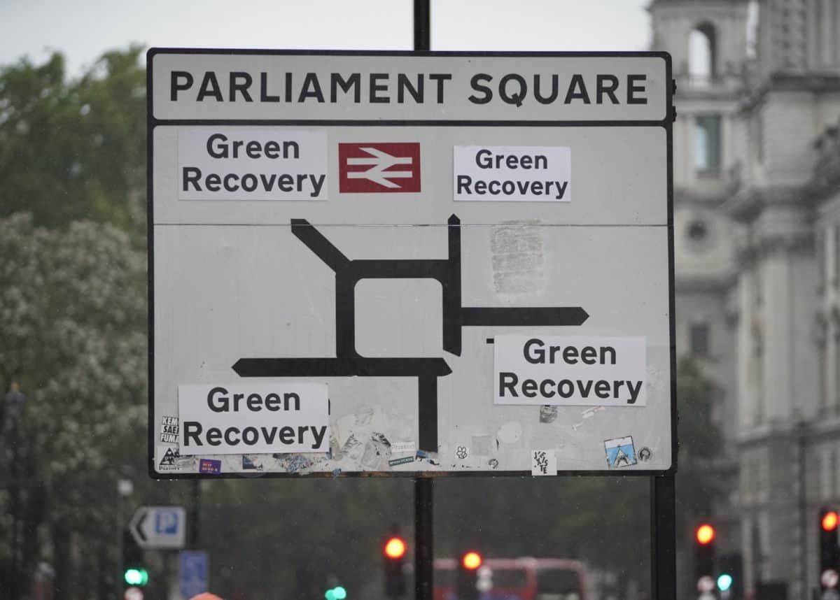 Greenpeace activists replace the destinations on the road signs around Westminster to read 'Green Recovery'. Sending a message to the government that it only has one option with its economic recovery package, and that much greater investment is needed to green the transport, energy, housing and waste sectors, create new green jobs and tackle the climate emergency.