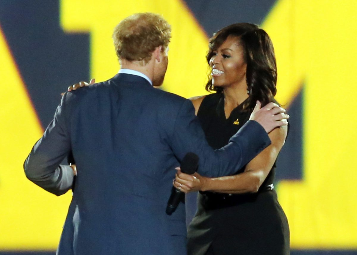 Prince Harry welcomes First Lady Michelle Obama onto the stage during the opening ceremony of the Invictus Games 2016 held at ESPN Wide World of Sports in Orlando, Florida.