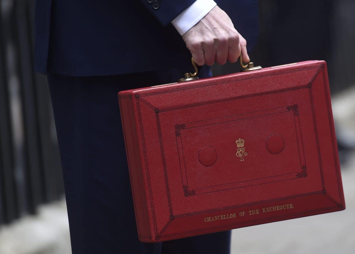 Chancellor of the Exchequer George Osborne holding his red Ministerial box outside 11 Downing Street, London, before heading to the House of Commons to deliver his Budget.