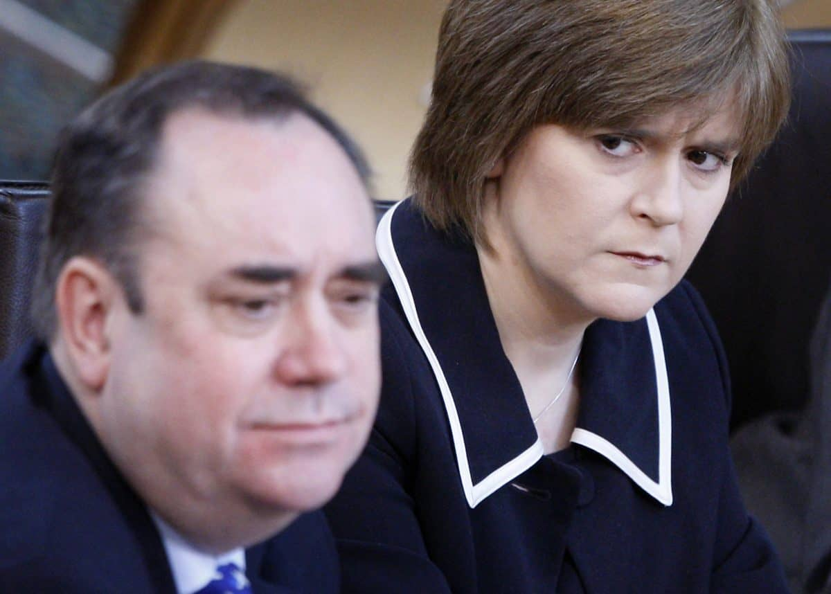 """File photo dated 11/02/10 of the then First Minister Alex Salmond and then Deputy First Minister Nicola Sturgeon during First Minister's Questions at the Scottish parliament in Edinburgh. Former first minister Alex Salmond, giving evidence before the Committee on the Scottish Government Handling of Harassment Complaints , has said there has been """"calculated and deliberate suppression of key evidence"""". Issue date: Friday February 26, 2021."""