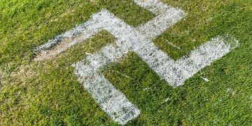 A giant Nazi swastika was painted across a football pitch by mindless vandals Credit;SWNS
