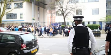 A police officer outside Pimlico Academy School, west London. Credit;PA