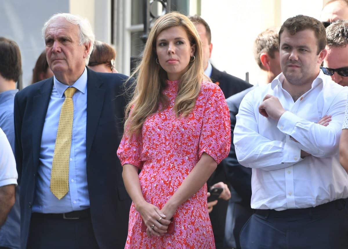 Eddie Lister (L) alongside Carrie Symonds.