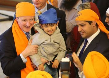 Image: PA Media Samir Jassal (right) with David Cameron on a visit to a Sikh place of worship in Kent, 2015