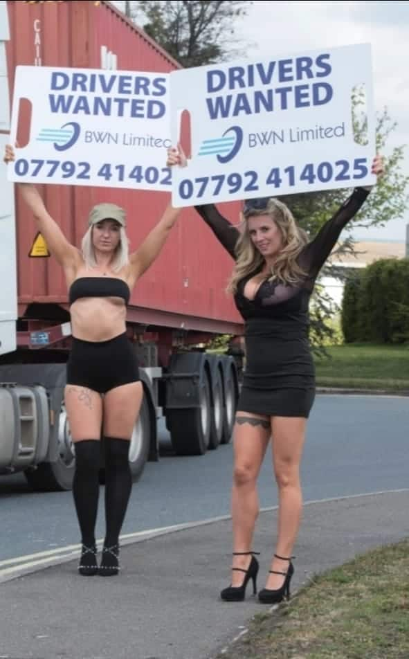 Adam Giles (middle) advertising lorry drivers vacancies.