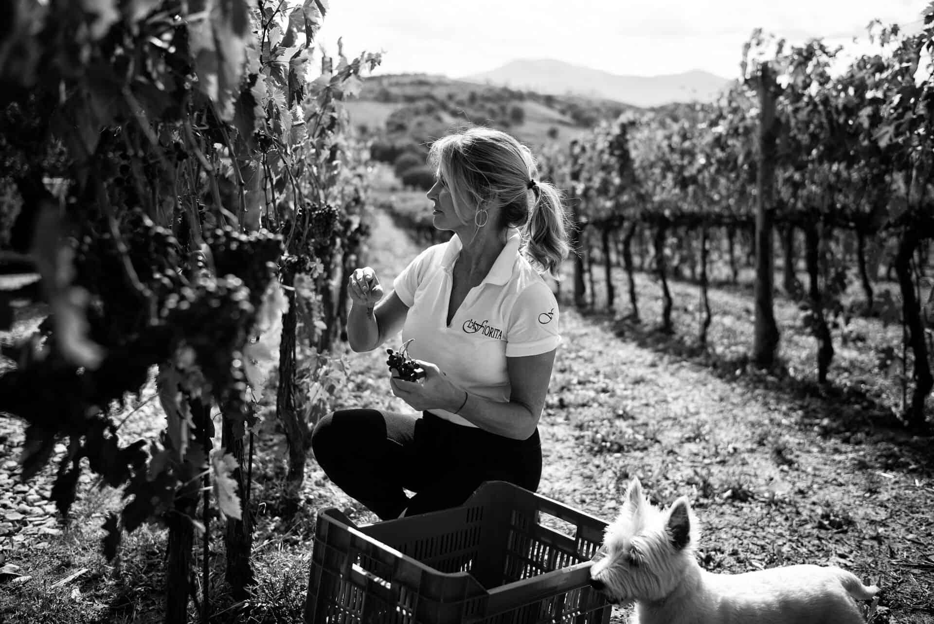 Natalie Oliveros in the vineyard with Bella Luna b&w