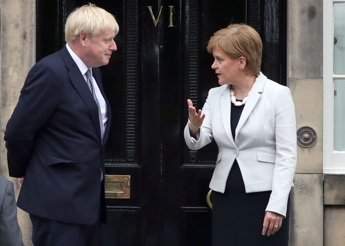 Scotland's First Minister Nicola Sturgeon welcomes Prime Minister Boris Johnson outside Bute House in Edinburgh ahead of their meeting.