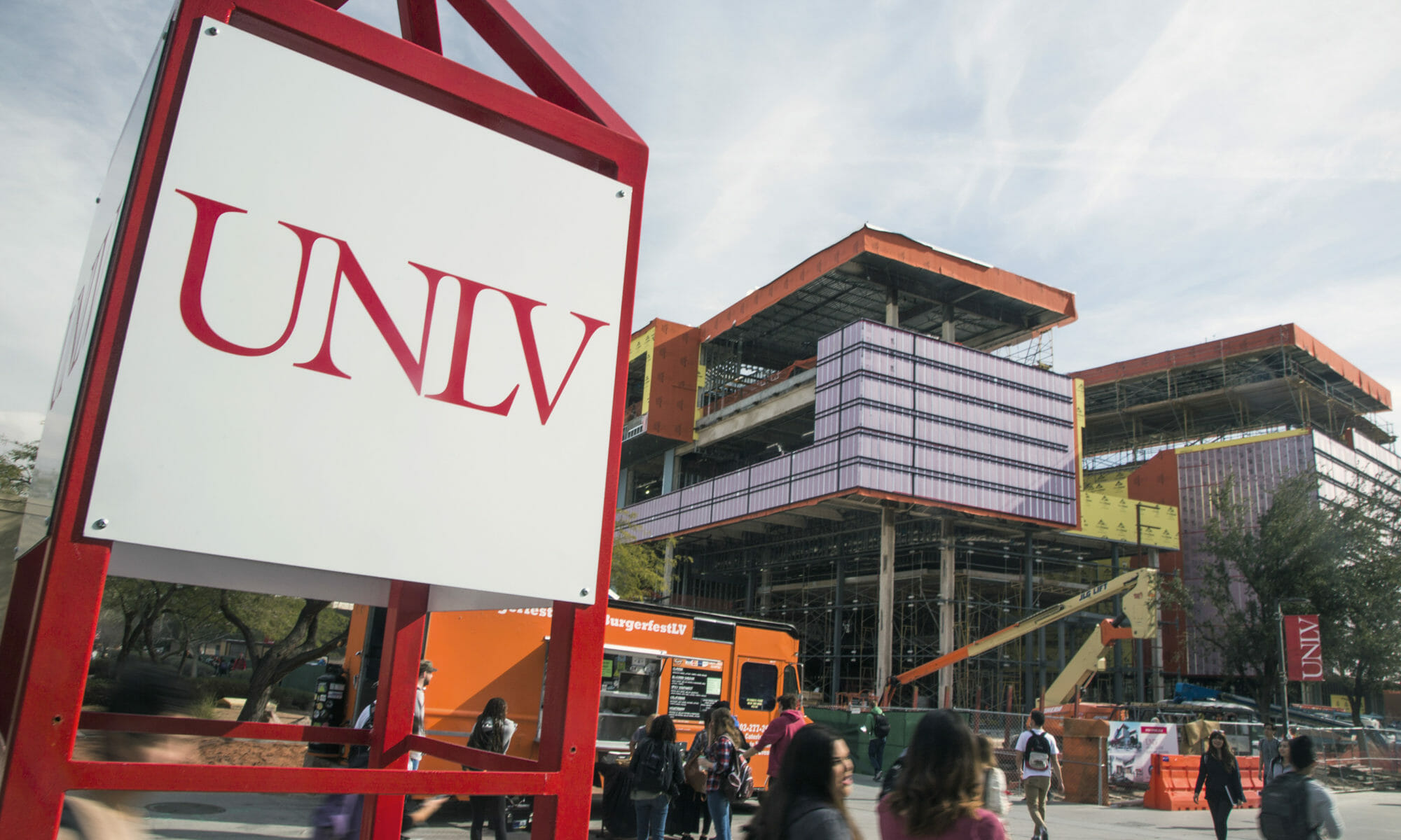 The UNLV Sign in front of the Hospitality Hall under construction