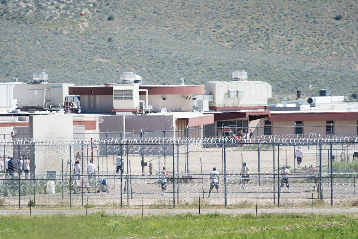 Inmates in the yard of a correctional facility.