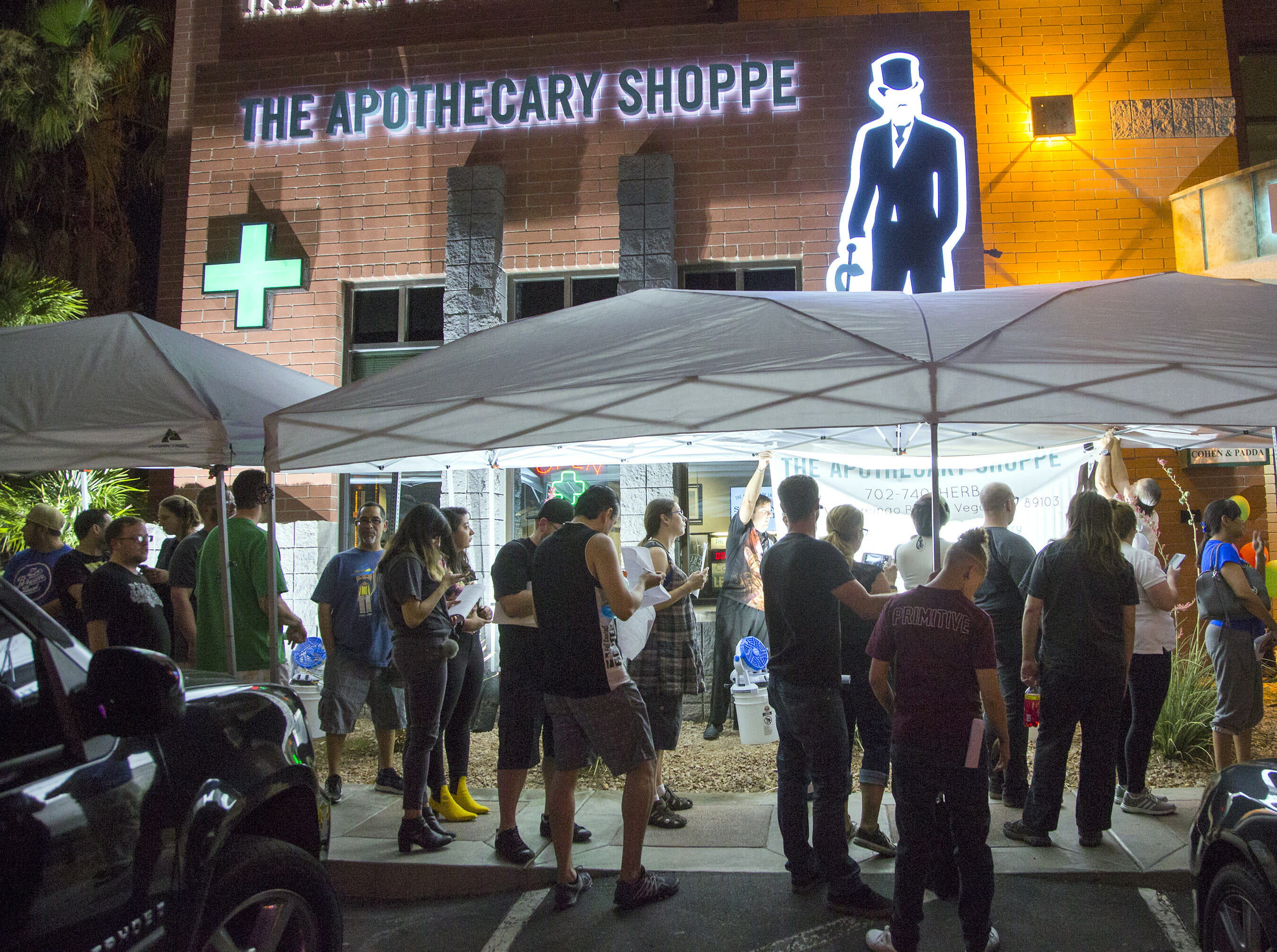 People stand in line at dispensary