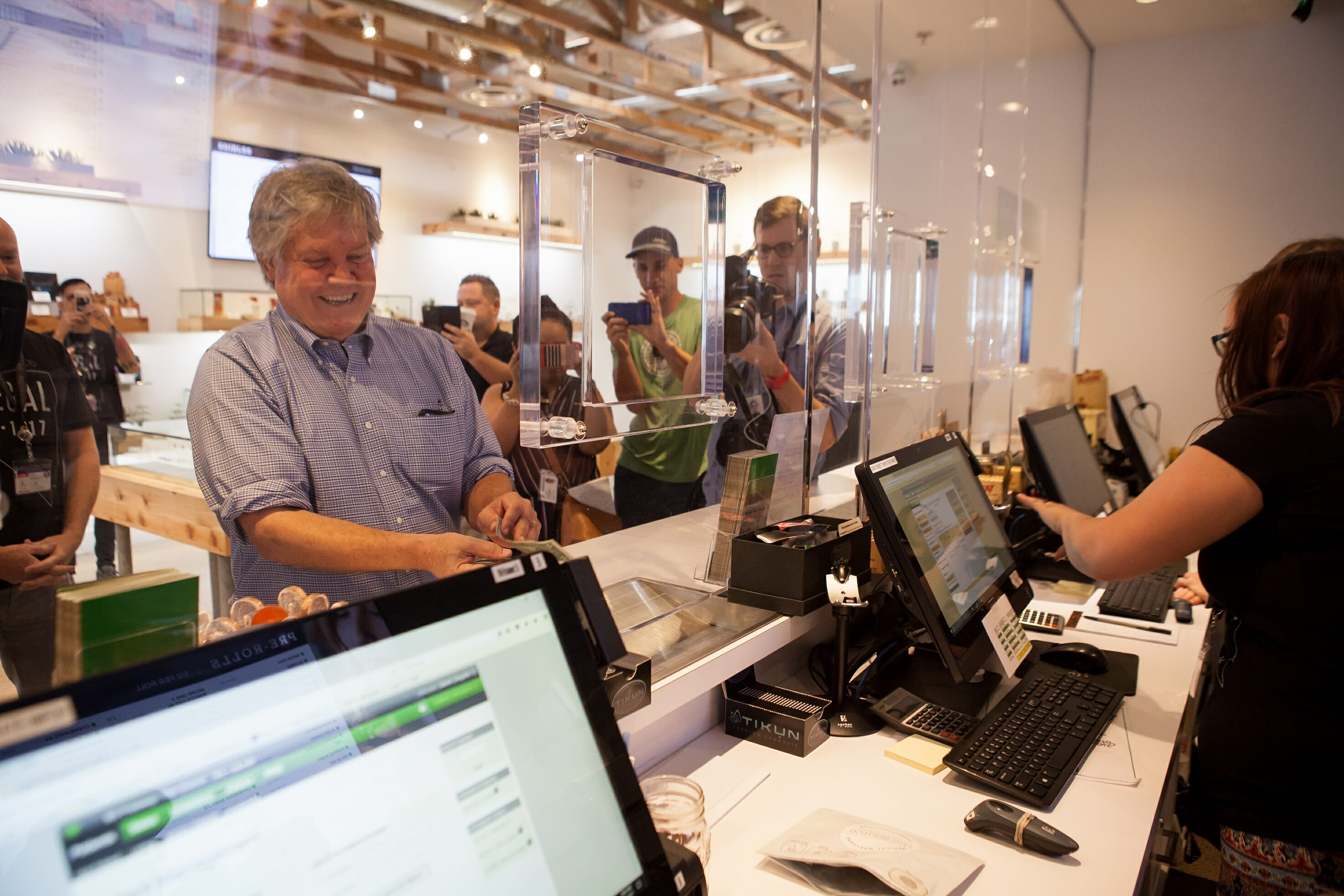 Senator Tick Segerblom standing in front of a cash register